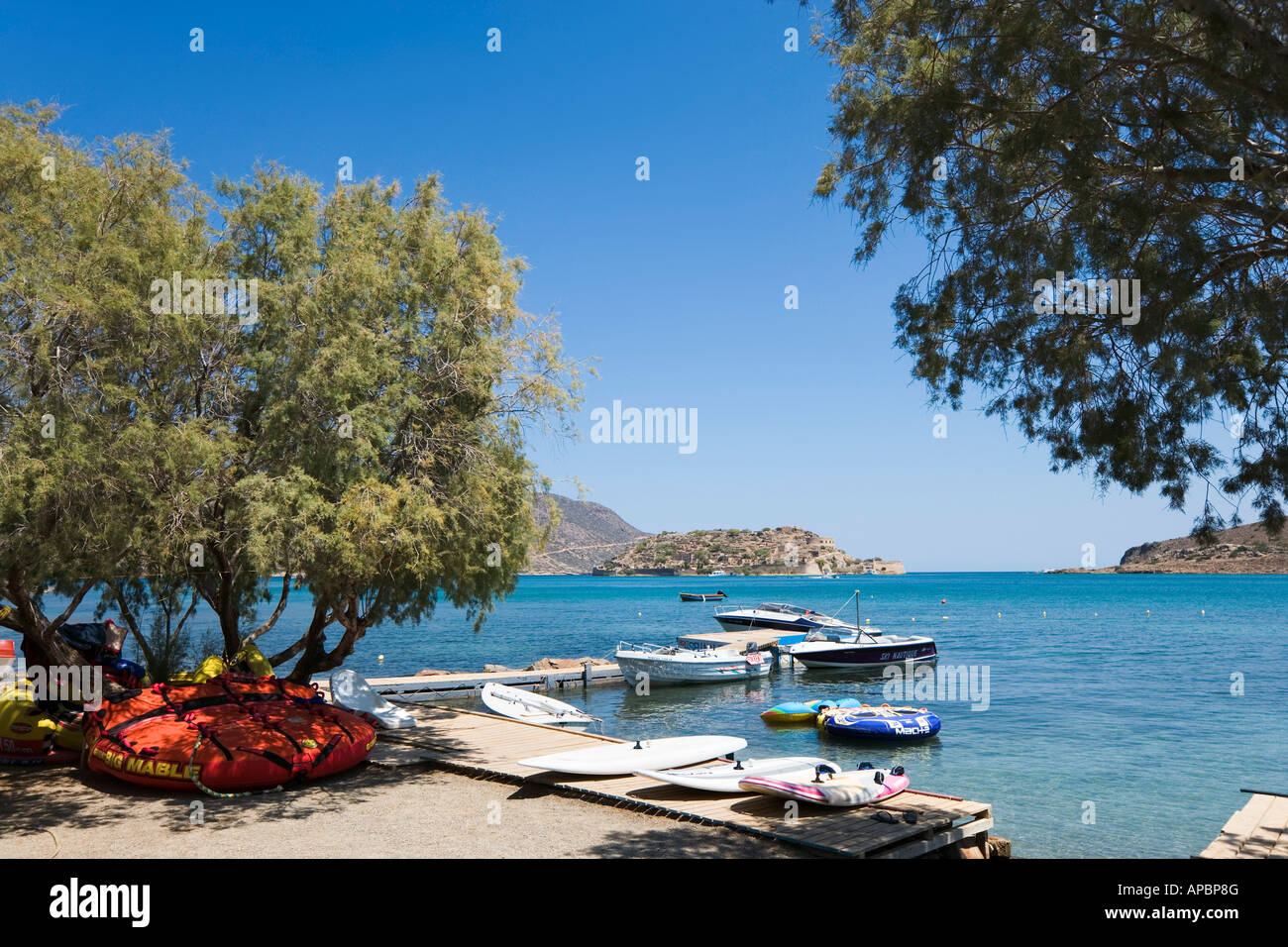 Watersports on Driros Beach with Spinalonga in the distance, Elounda, North East Coast, Crete, Greece - Stock Image