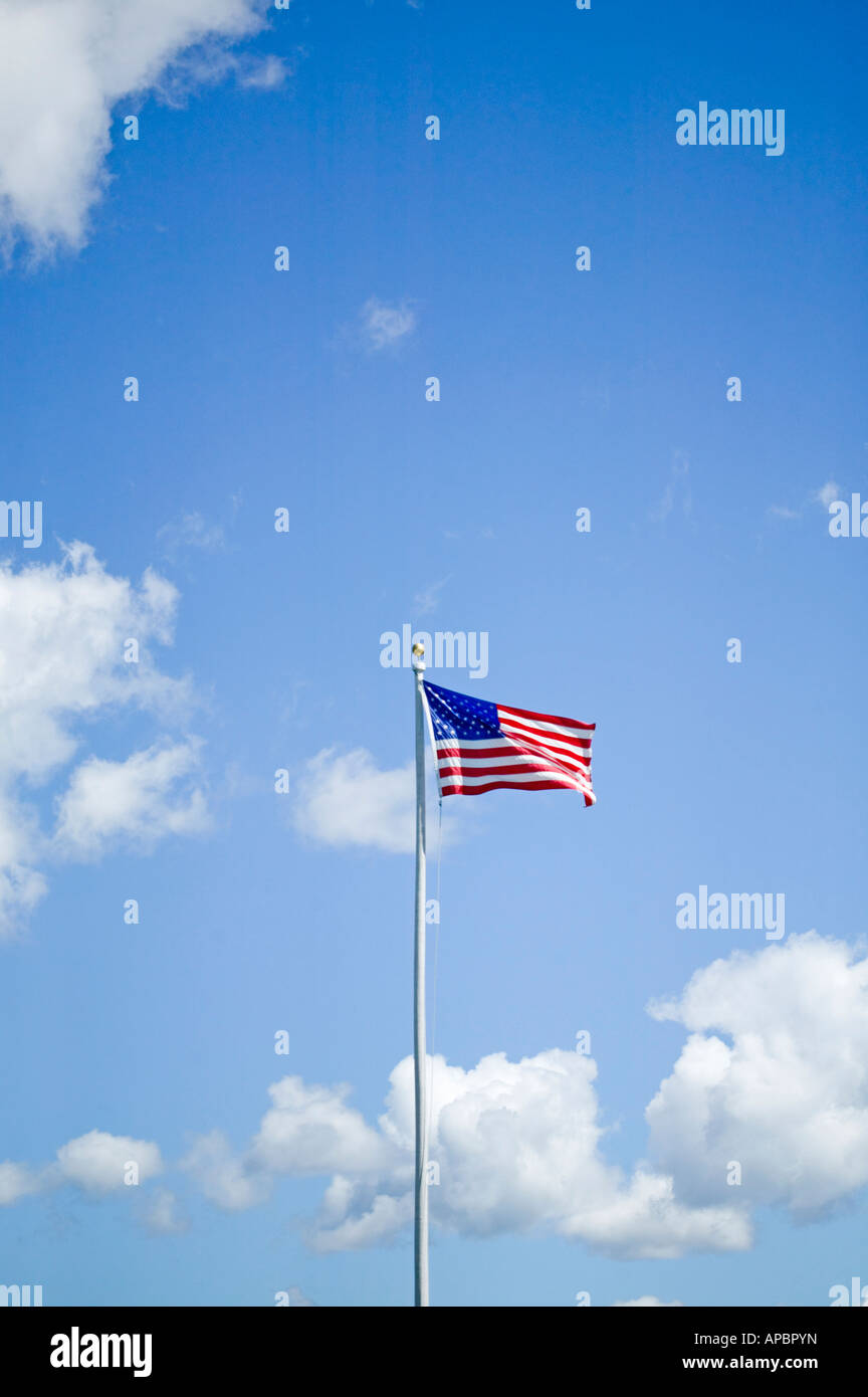 American flag stars and stripes on flagpole blows in the wind patriotic proud Americana USA red white and blue America - Stock Image