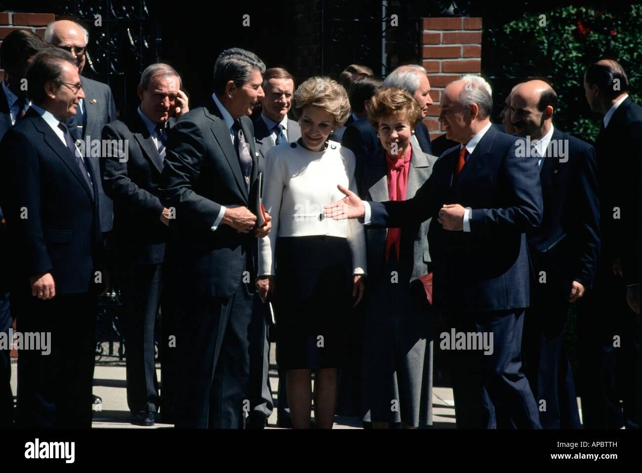 Soviet President Mikhail Gorbachev reaches out for Former US President Ronald Reagan's Hand. - Stock Image