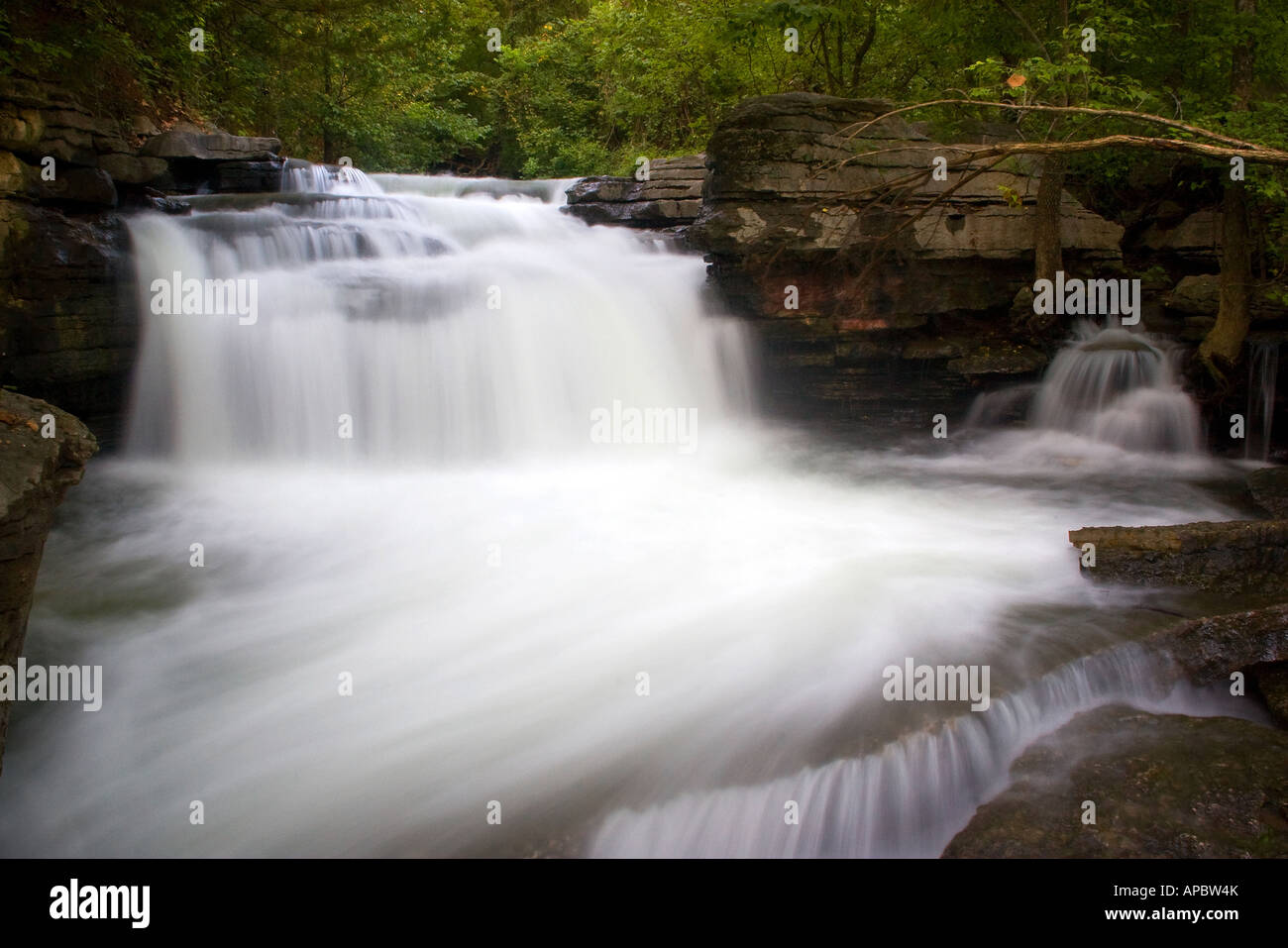 Water flows over a waterfall below the Lake Ann dam in Bella Vista, Ark. Stock Photo