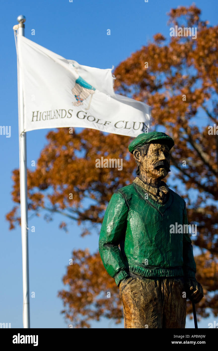 Mulligan, a wooden statue, looks out over the Highlands Golf Club at the Highlands Golf Course in Bella Vista, Ark. Stock Photo