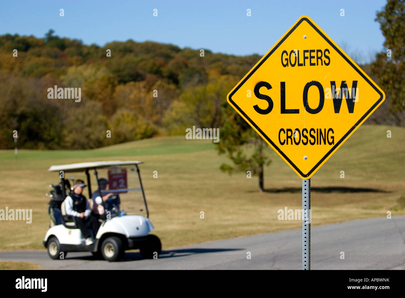 Golfers make their way on a path in their golf cart at Country Club Golf Course in Bella Vista, Ark. Stock Photo