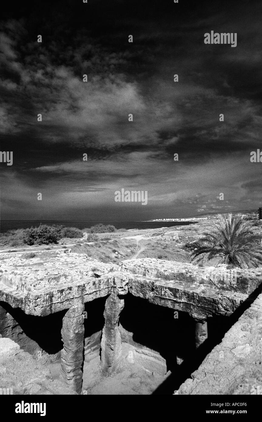 Moody sky over Cyprus, at the Tomb of the Kings, a popular tourist destination - Stock Image