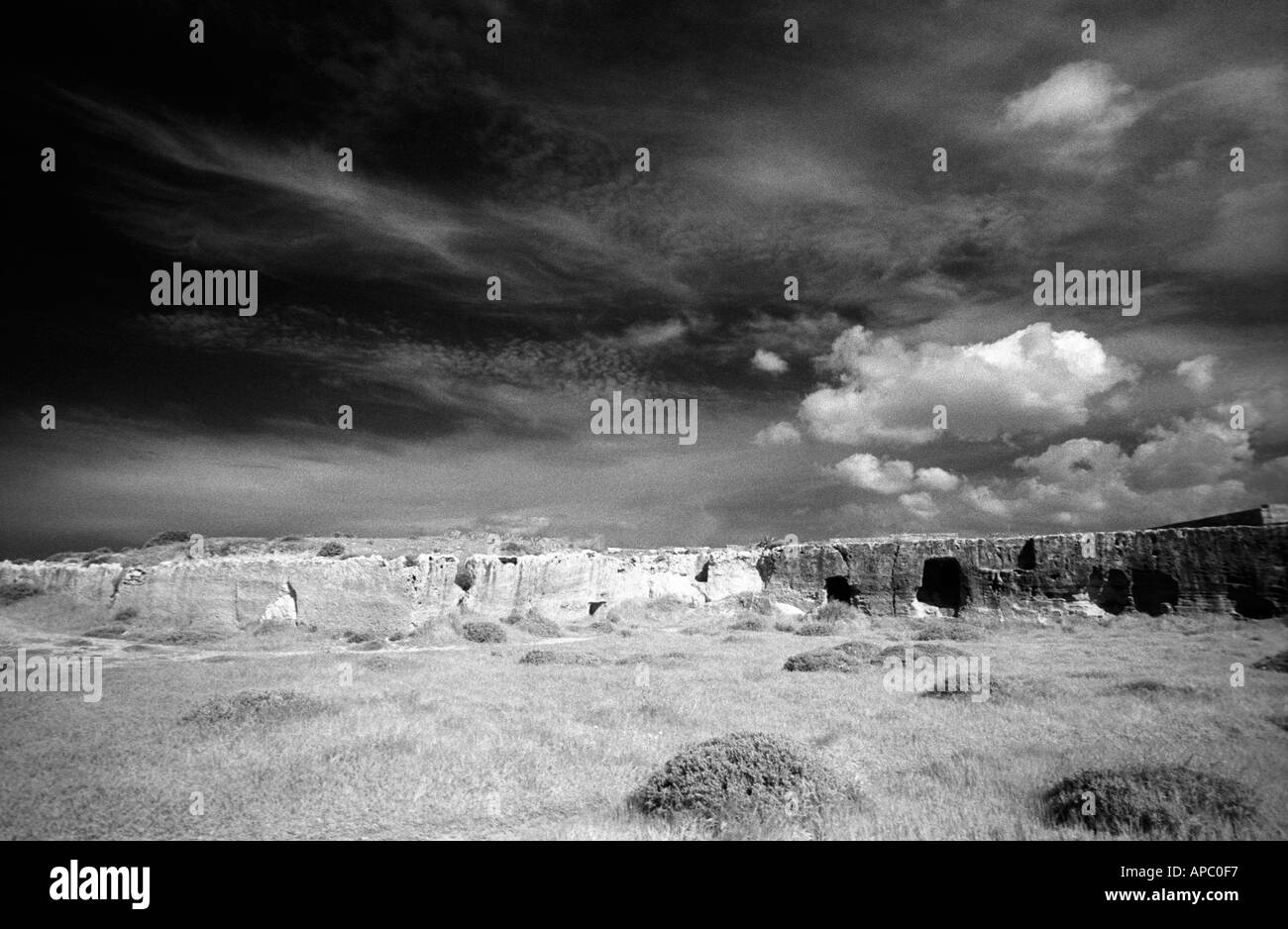 Wild Dawn sky. Moody sky over Cyprus, at the Tomb of the Kings, a popular tourist destination - Stock Image