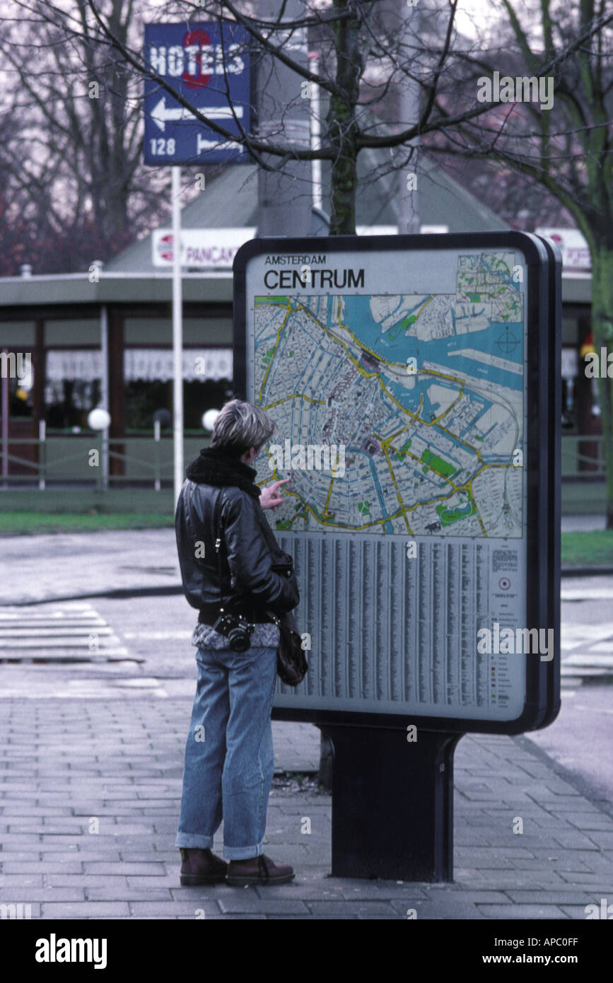 Map of amsterdam stock photos map of amsterdam stock images alamy tourist looking at street map in amsterdam the netherlands stock image publicscrutiny Images