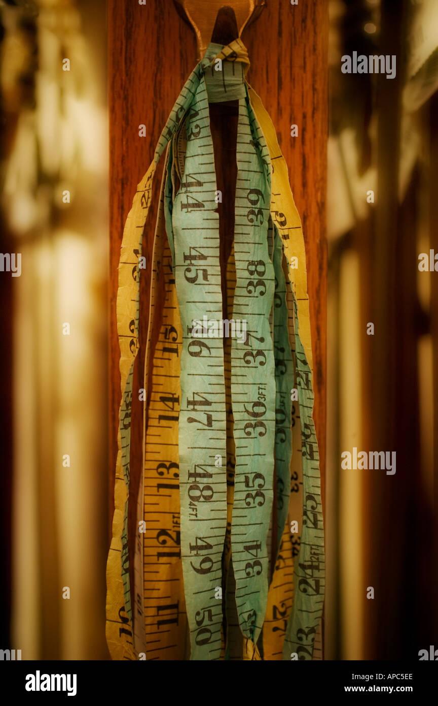Measuring Tape in Dressing Room 1 - Stock Image
