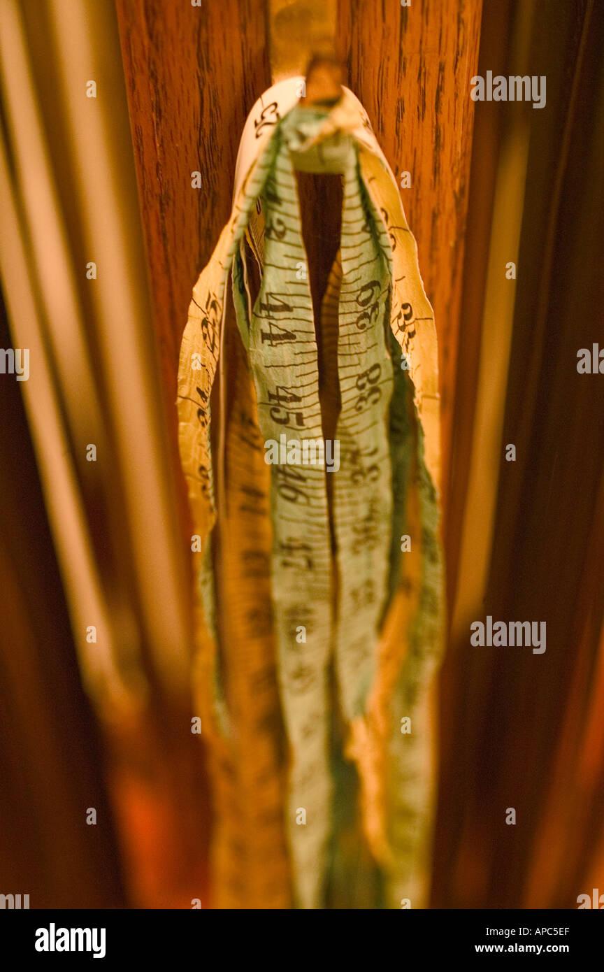 Measuring Tape in Dressing Room 2 - Stock Image