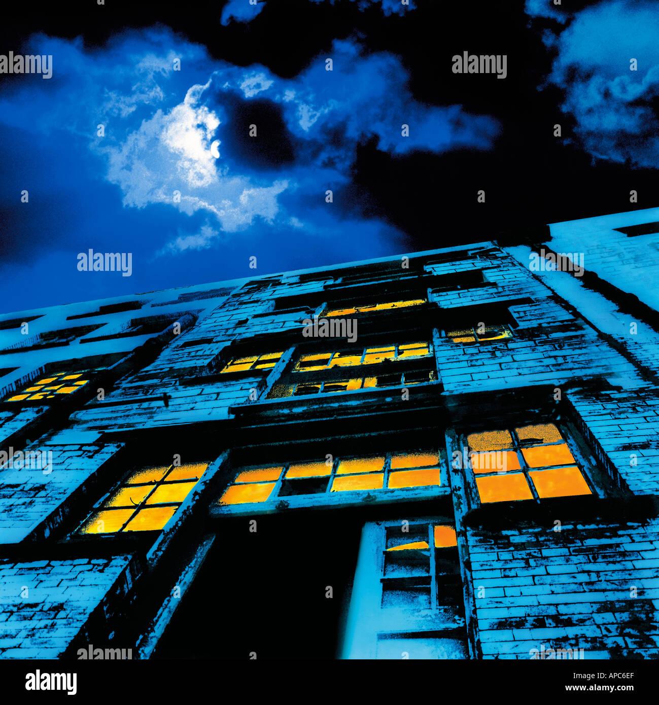 old warehouse building isle of dogs night blue full moon stylised london england uk - Stock Image