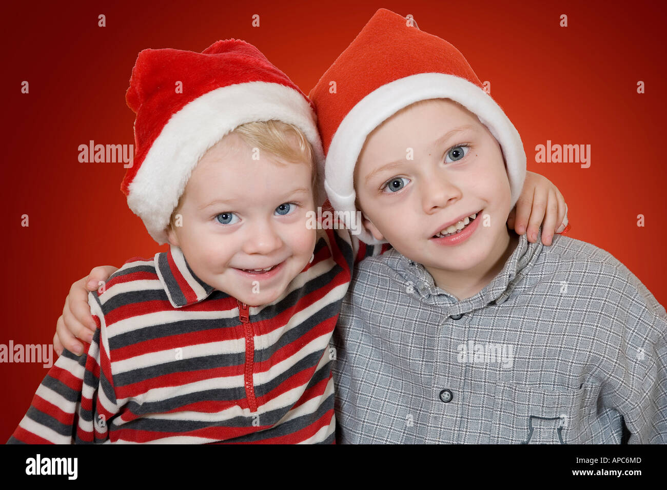 Two little boys with X-Mas caps - Stock Image