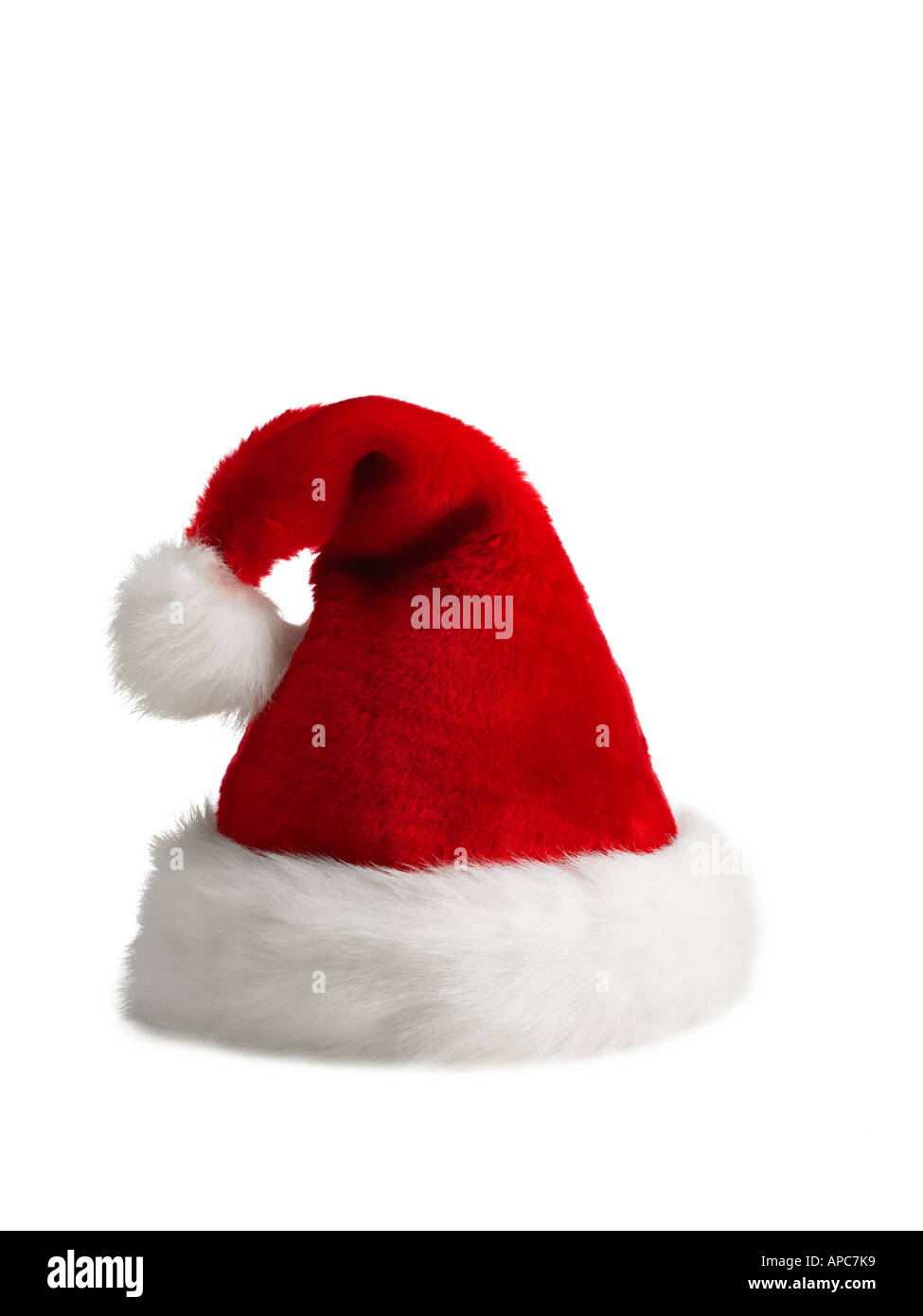 red furry Santa Hat on a white background - Stock Image