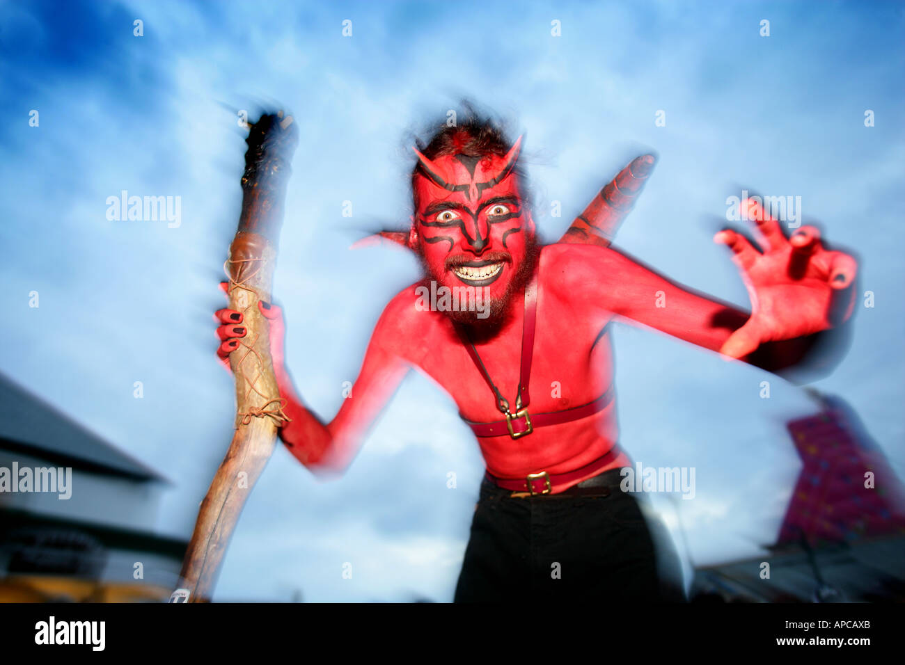 Devil performers at Lands end cornwall - Stock Image