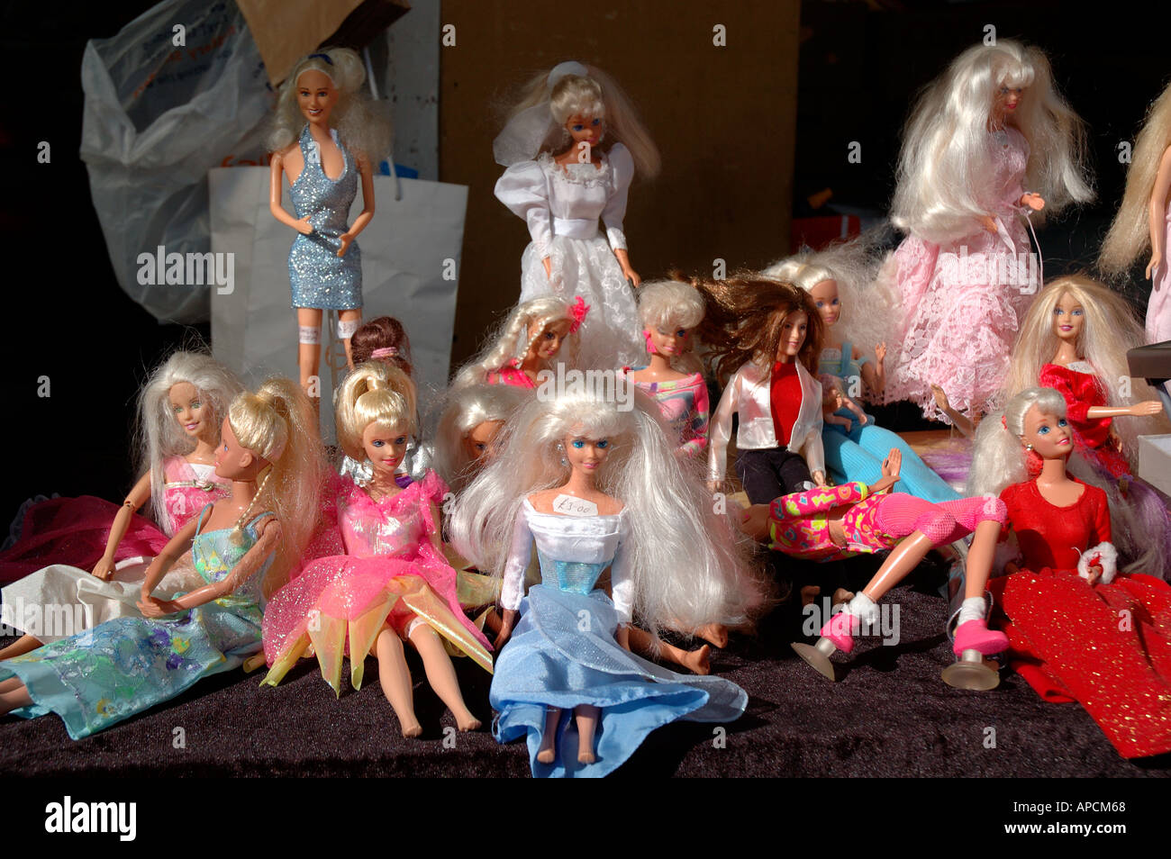 Secondhand Barbie dolls for sale at a bootsale. - Stock Image
