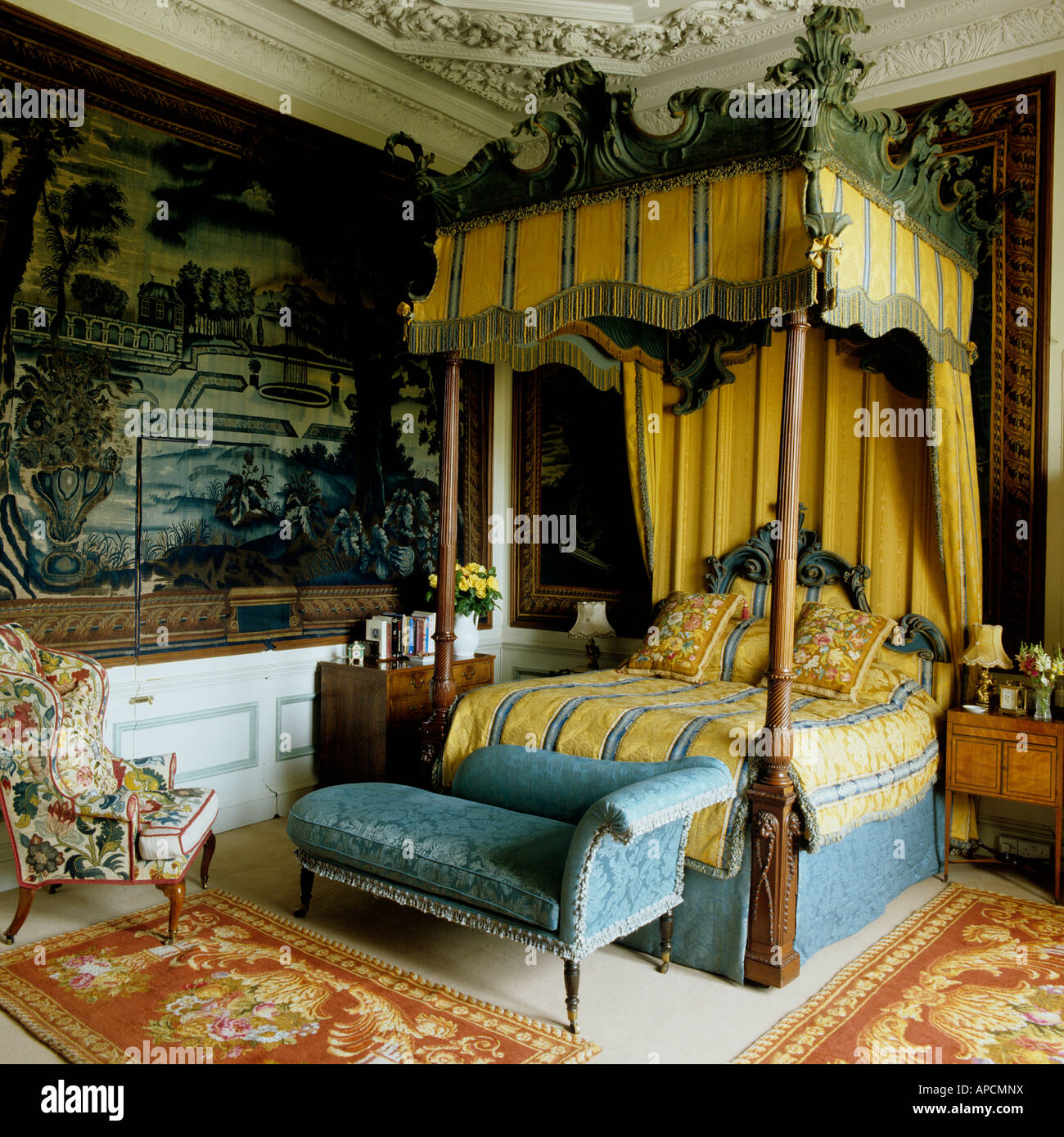 Fourposter bed in bedroom with tapestry at Burghley House, England - Stock Image