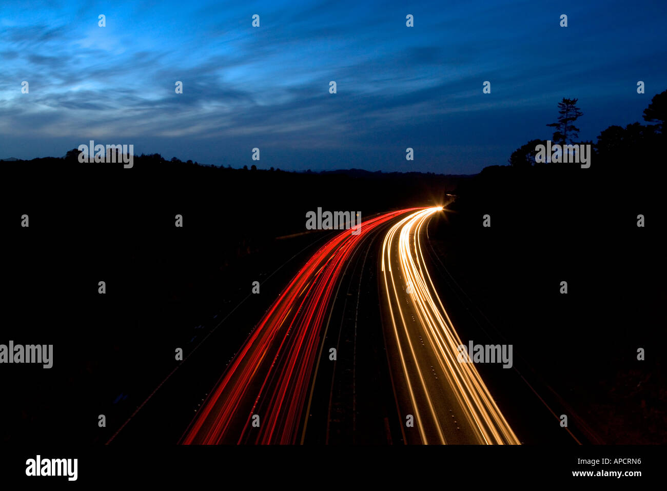 Motorway Traffic at night on SH1 Auckland New Zealand - Stock Image