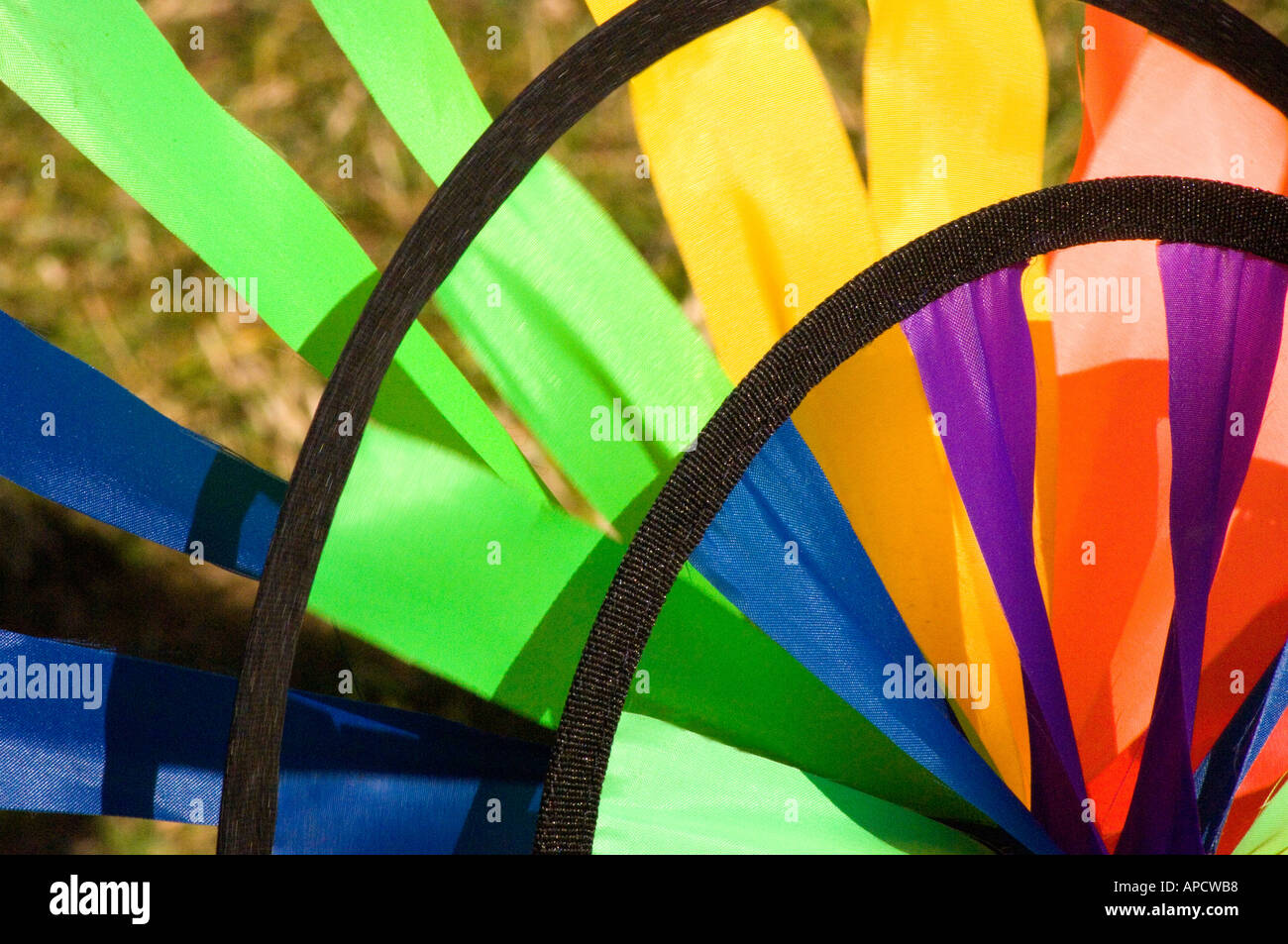 Colourful windmill garden ornament in the summer sunshine - close-up shot Stock Photo