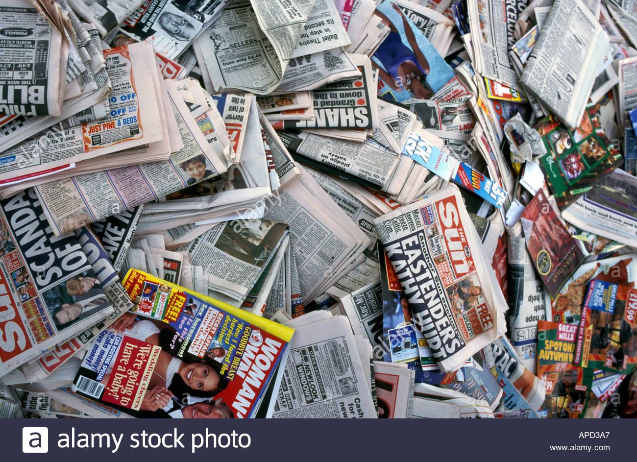 Pile of newspapers and magazines for recycling uk stock for How to recycle old magazines