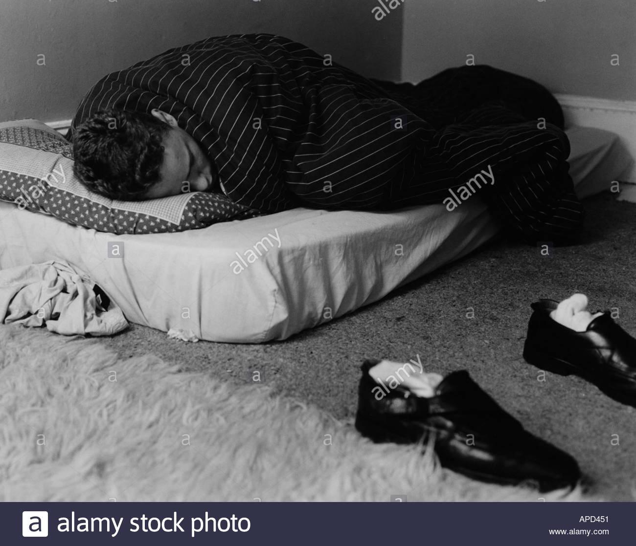 Teenager Sleeping On Mattress On Floor Uk Stock Photo 1496144 Alamy