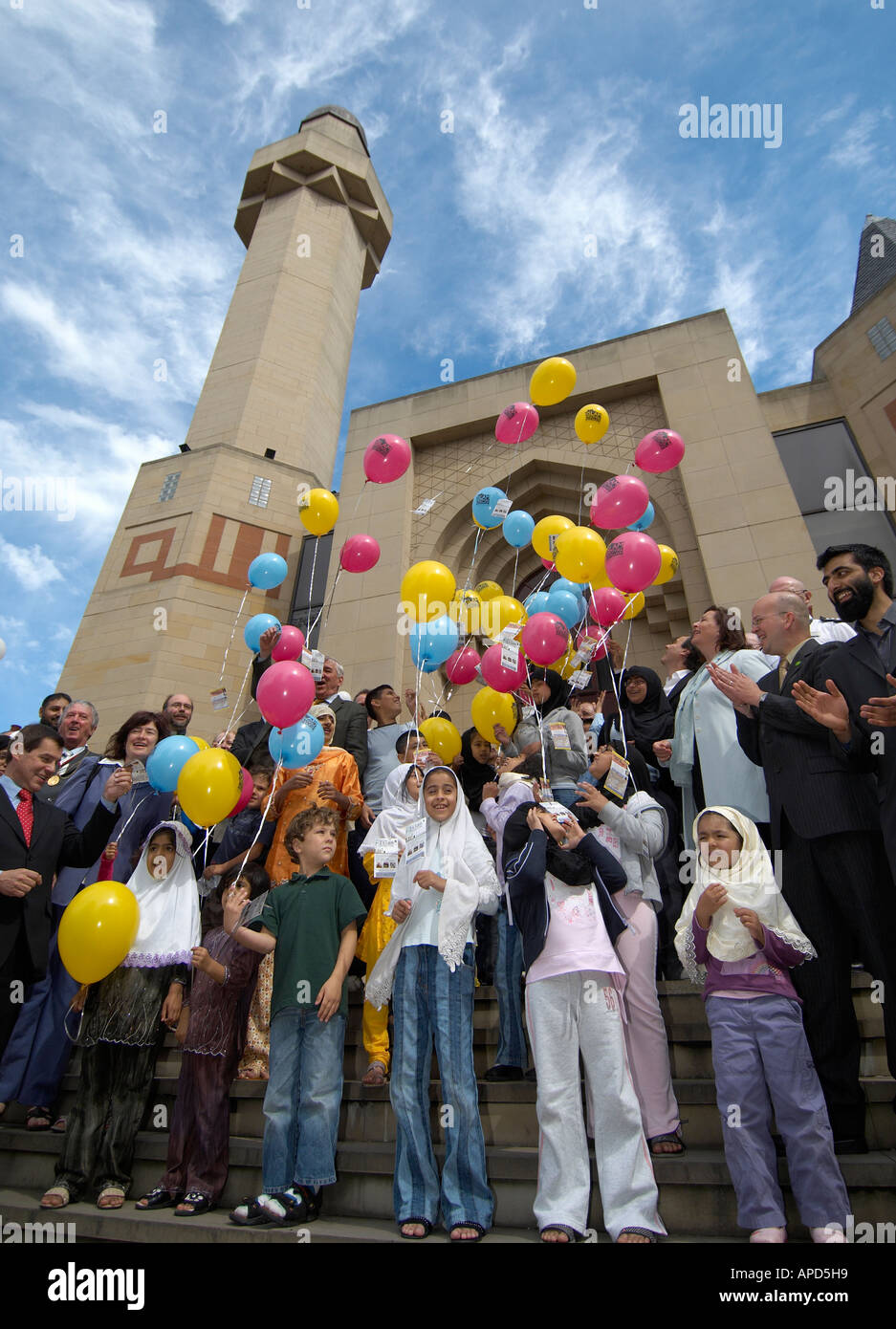 Children launching balloons in front of Edinburgh Central Mosque Stock Photo