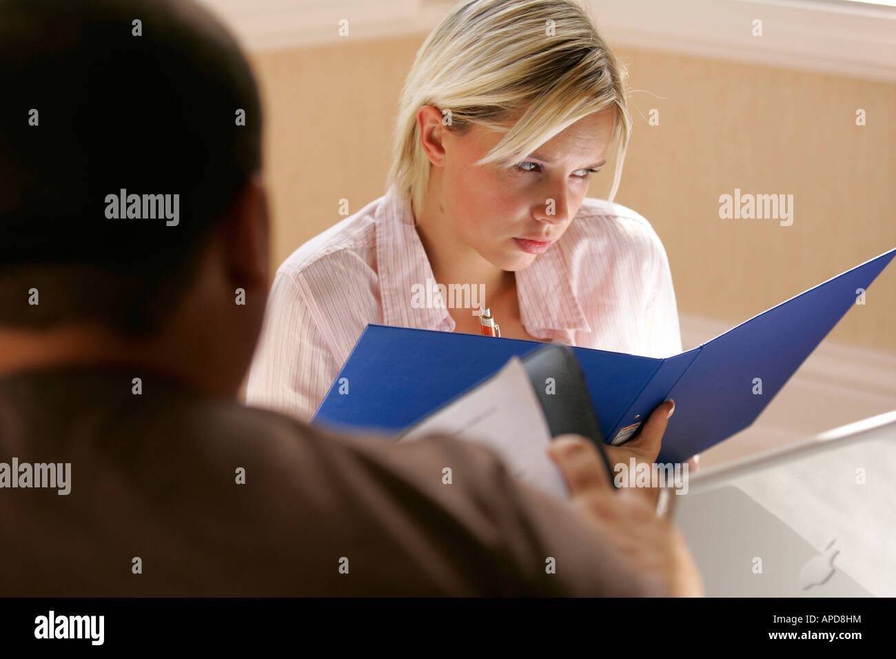 woman interviewing a candidate for a job - Stock Image