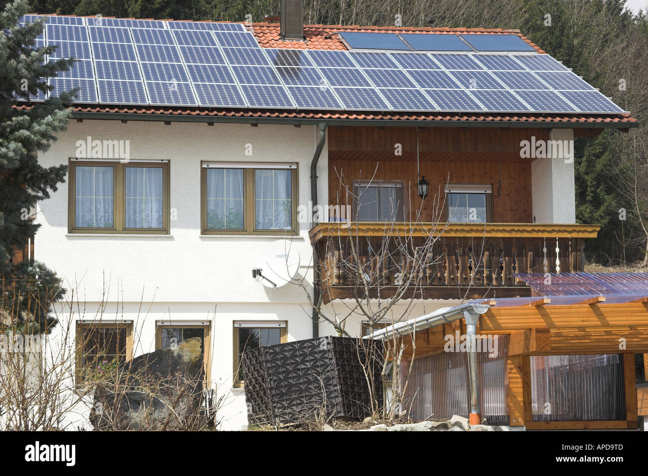 Private house roof in Southern Germany covered with PV (photovoltaic) cells for electricity generation Stock Photo