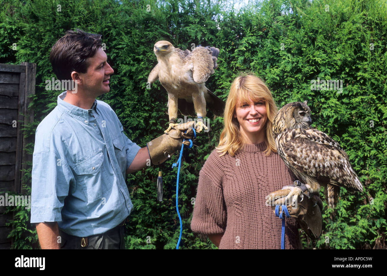 Long Sutton Falconry Park, Lincolnshire, birds male and female handlers falcons birds of prey England UK - Stock Image