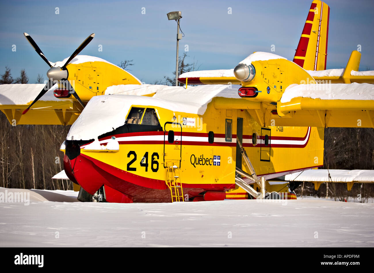 A Bombardier 415 lies in the snow at the Quebec City airport - Stock Image