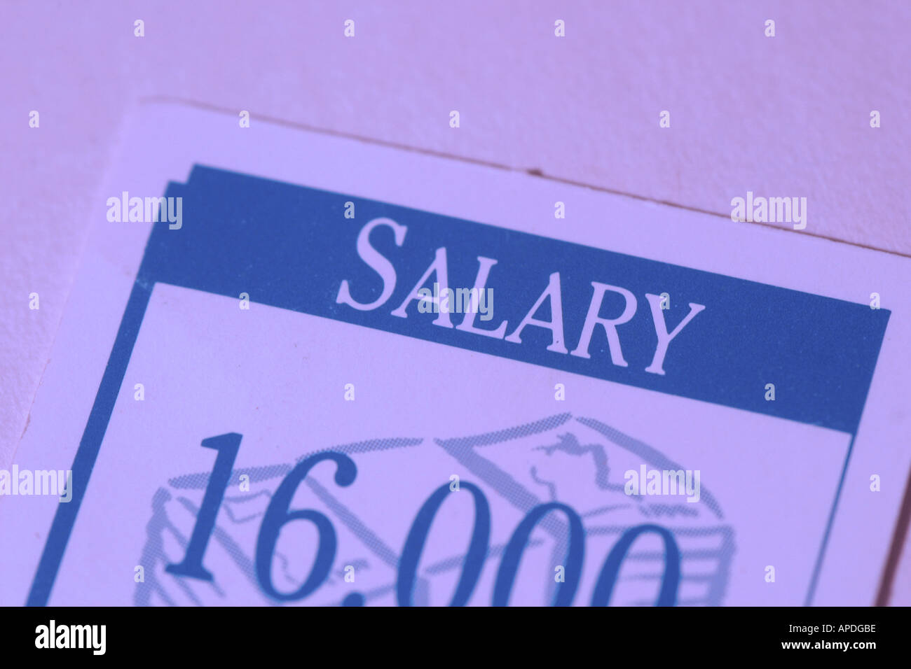 a card about salary from a game - Stock Image