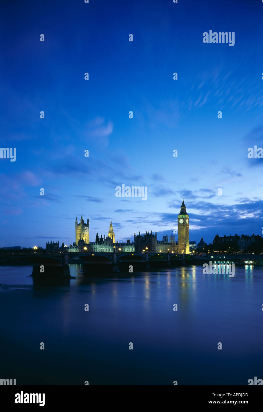Big Ben and Houses of Parliament viewed across Westminster Bridge at dusk. Architect: Charles Barry , A. W. N. Pugin - Stock Image