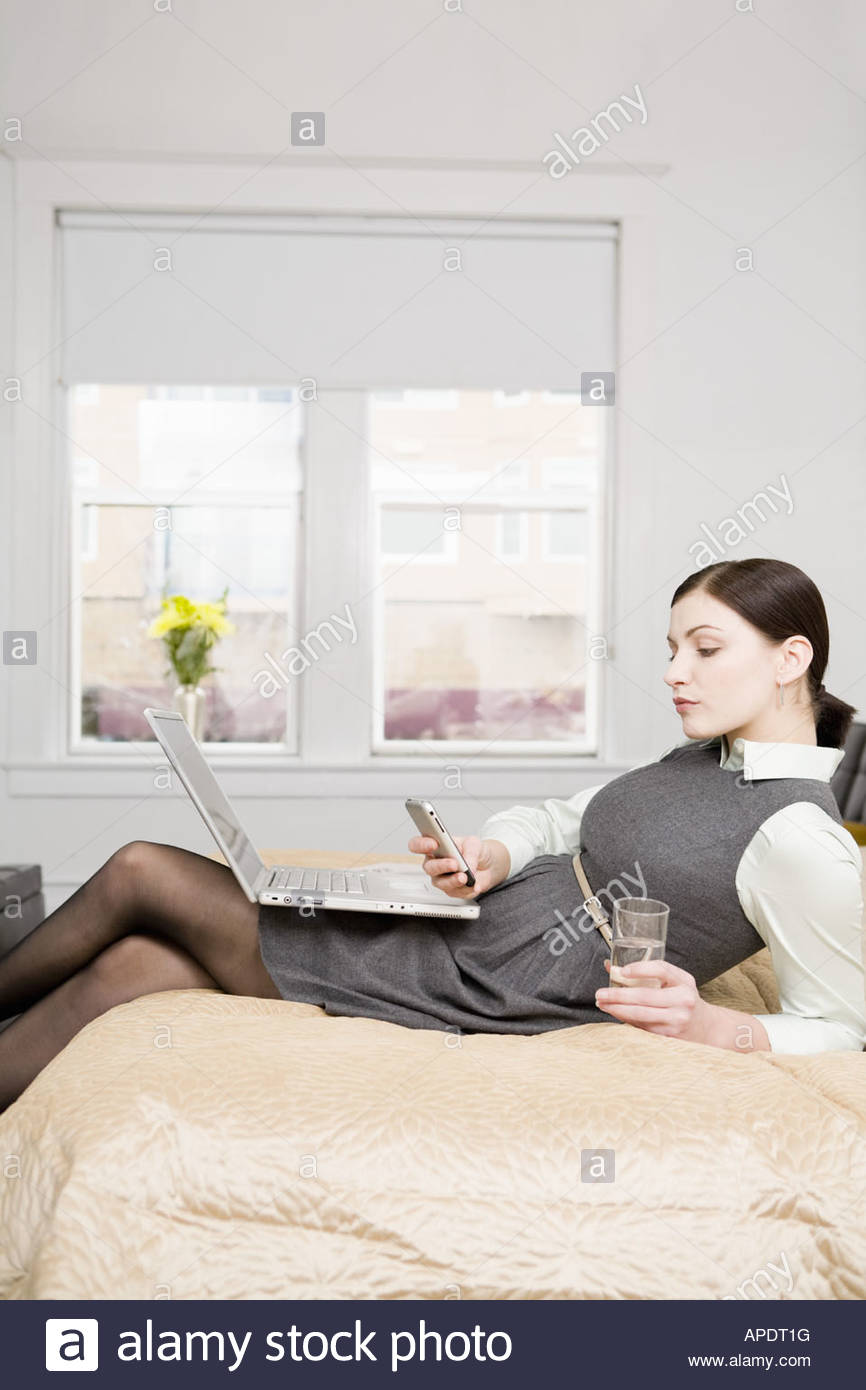 Businesswoman dialing cell phone - Stock Image