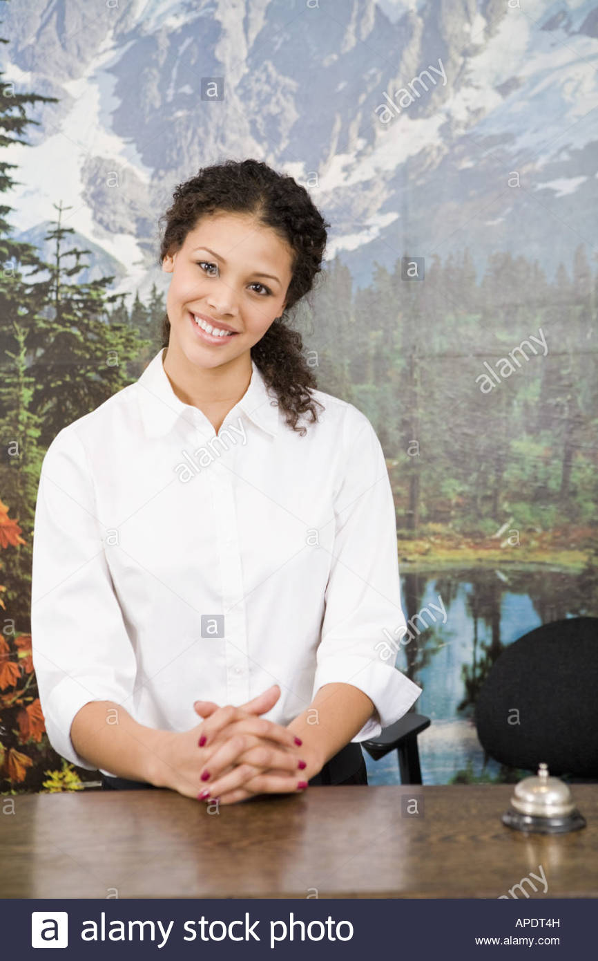 African woman standing behind counter - Stock Image