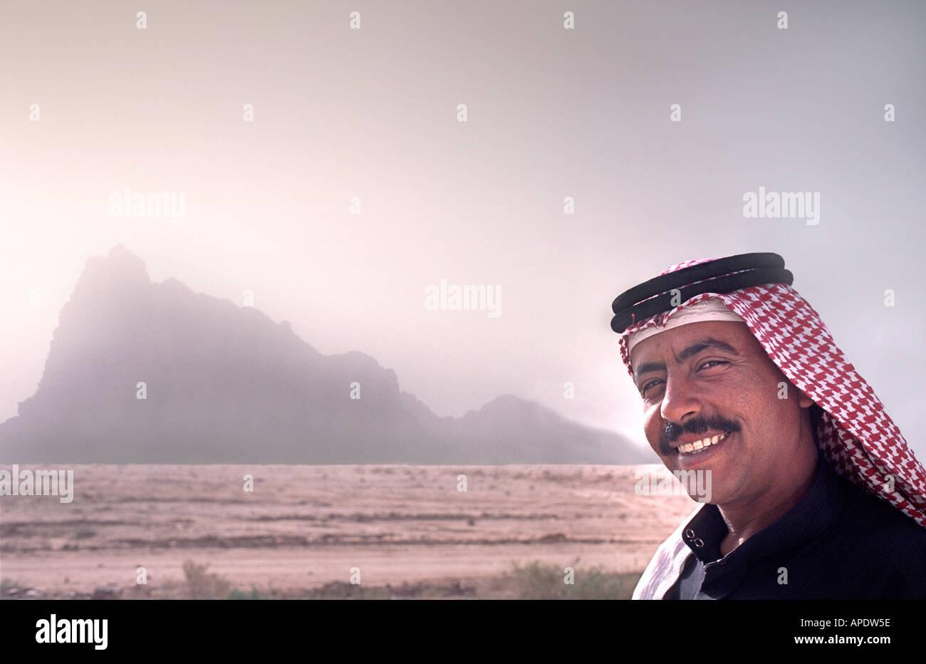 Jordanian Bedouin man wearing a keffiyah a traditional Arab headscarf Wadi Rum Jordan - Stock Image