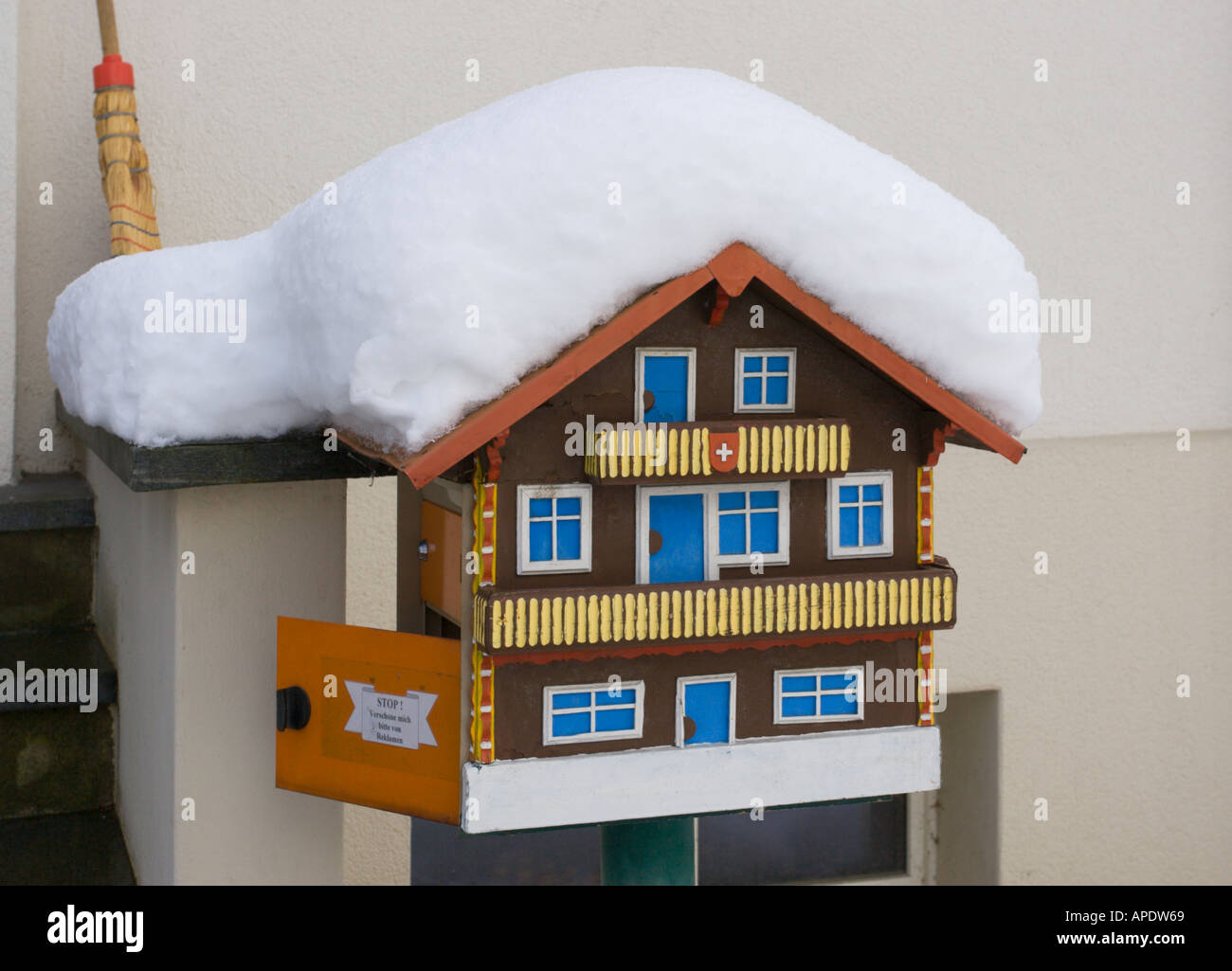Home Letterbox Made As A Small Miniature Swiss Chalet On Short Pole Outside Local Persons House Covered In Snow Switzerland