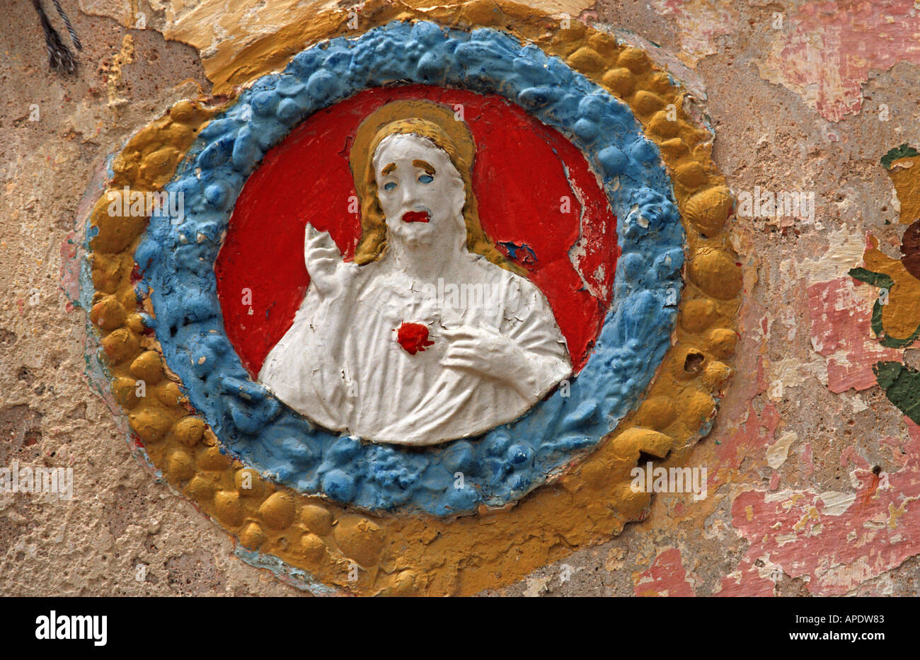 Painted bas relief of Jesus Christ on a wall in the street Vittoriosa Malta - Stock Image