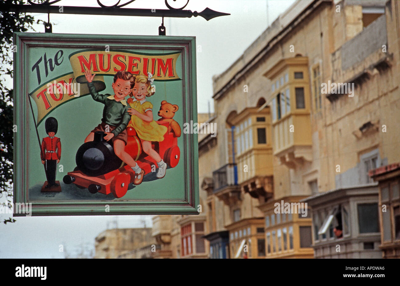 Sign for the Toy Museum above a narrow Valletta street Malta - Stock Image