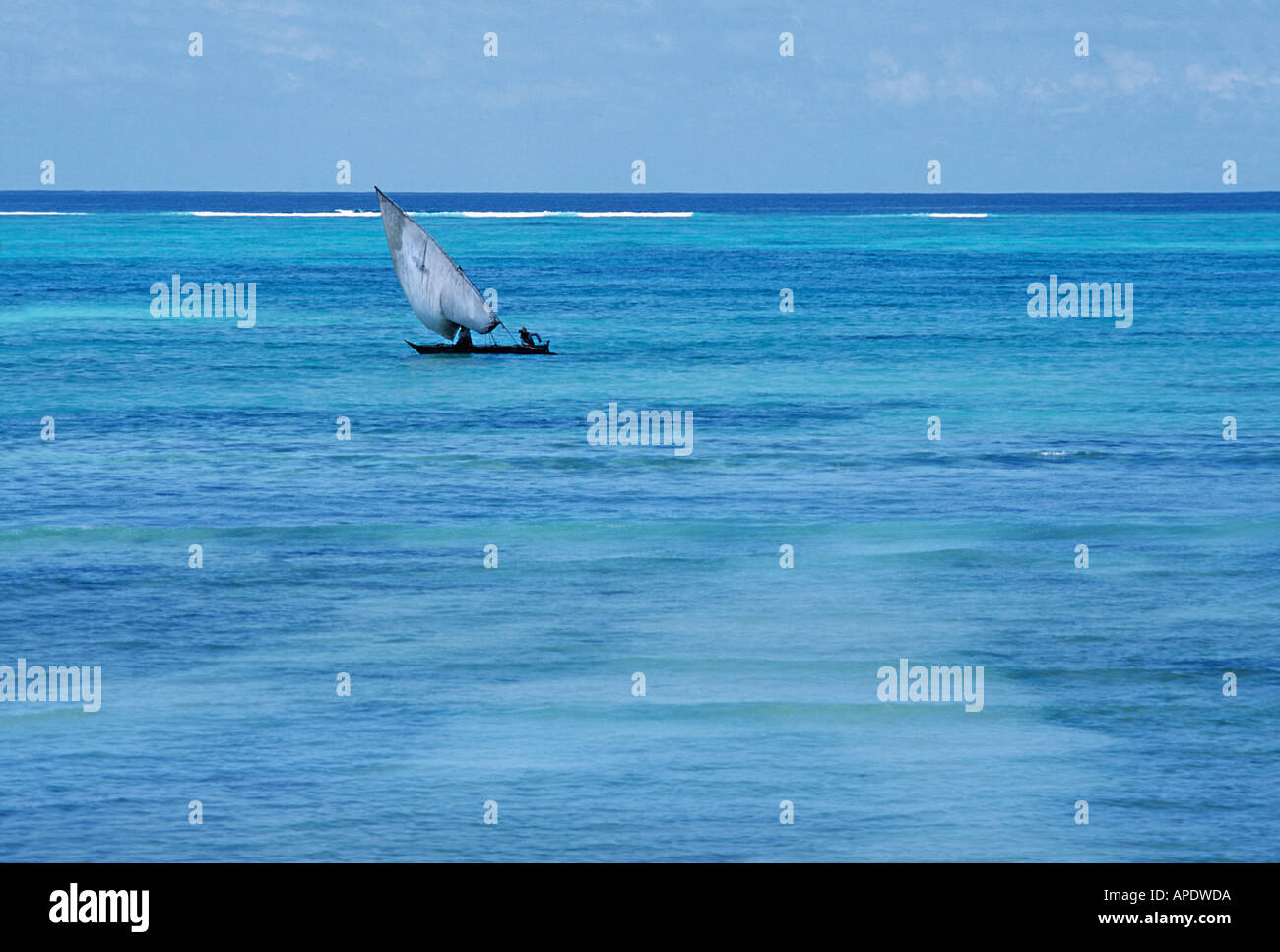 Nungwi Zanzibar TANZANIA Fisherman in a dhow on bright turquoise waters off the coast of northern Unguja - Stock Image