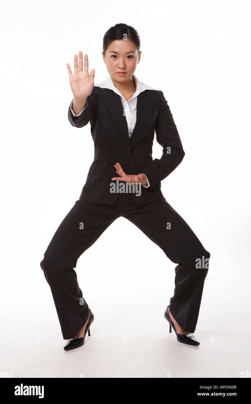 Young woman in business suit in kung fu pose Stock Photo: 9006282