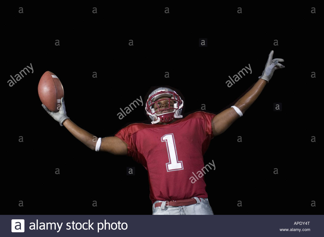 African football player with arms outstretched - Stock Image