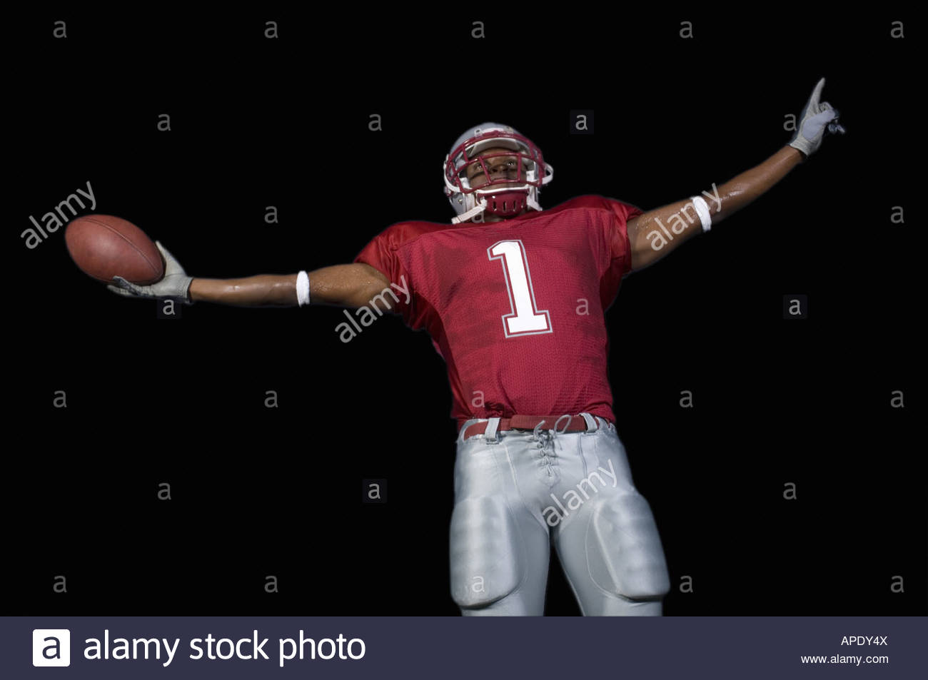African football player arms outstretched - Stock Image