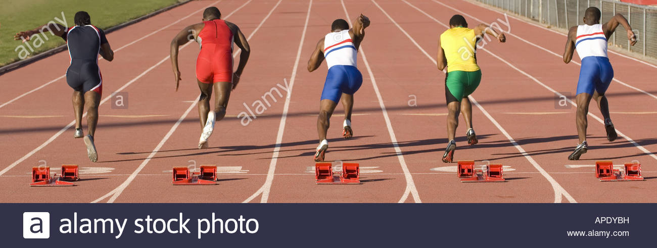 Runners racing on outdoor track - Stock Image