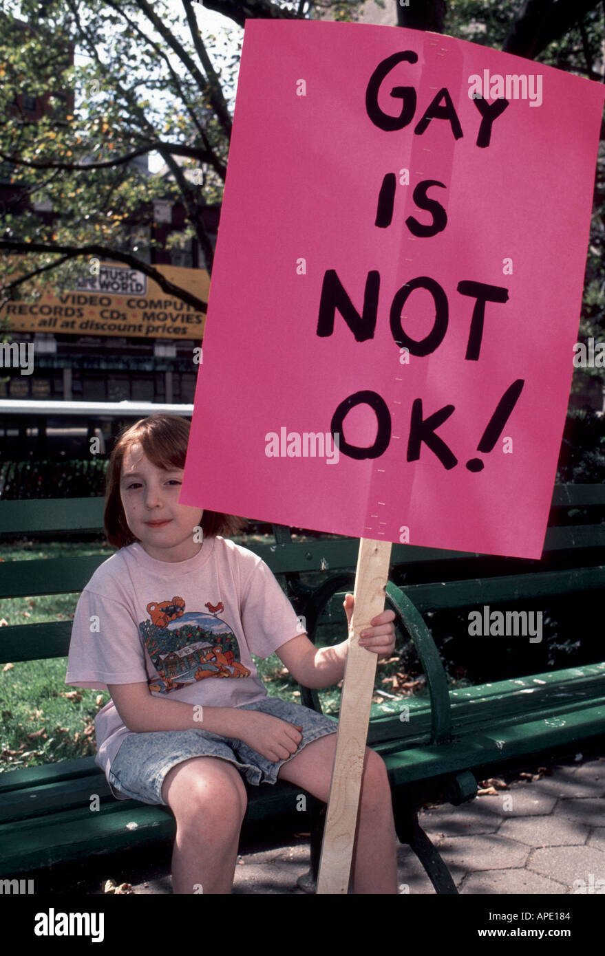 Child holds anti gay sign at protest  - Stock Image