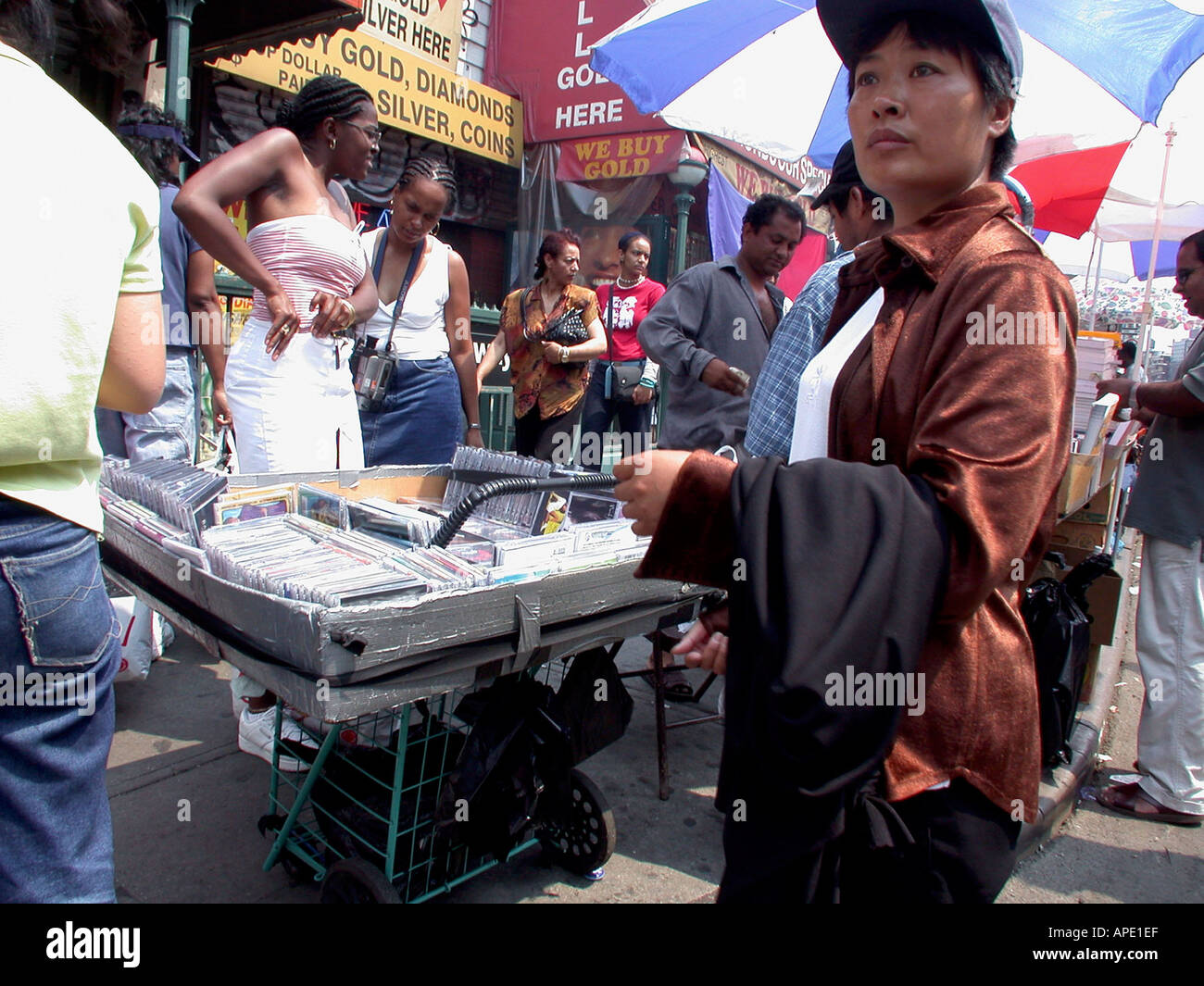Vendors on Canal Street in Chinatown sell illegal copies of music CD s and DVD s and videos of current films - Stock Image