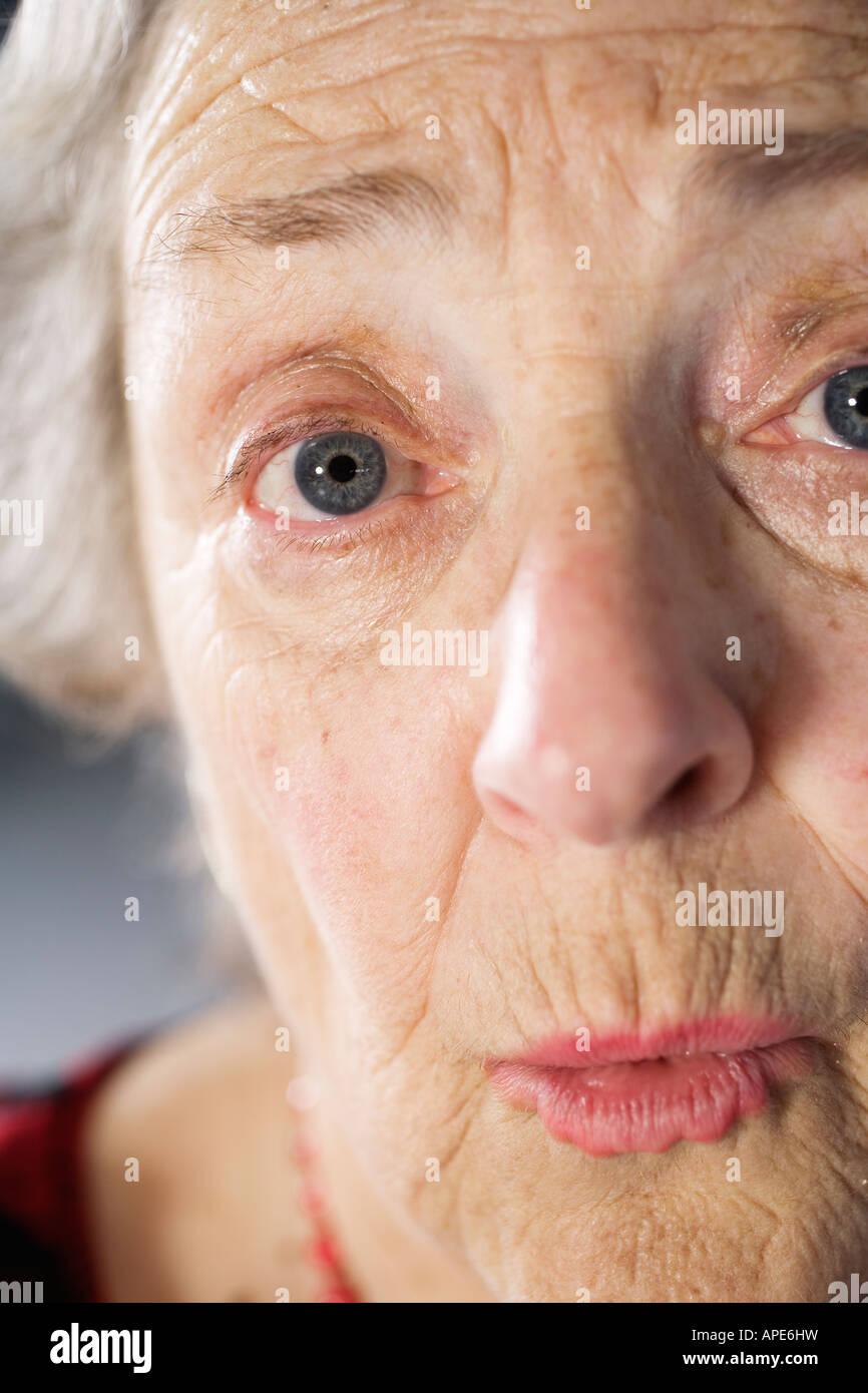 Portrait of a shocked senior woman. - Stock Image