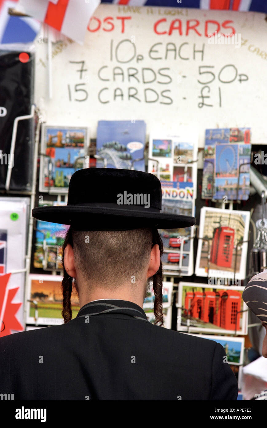 An Orthodox Jew at a postcard stand in London England UK - Stock Image