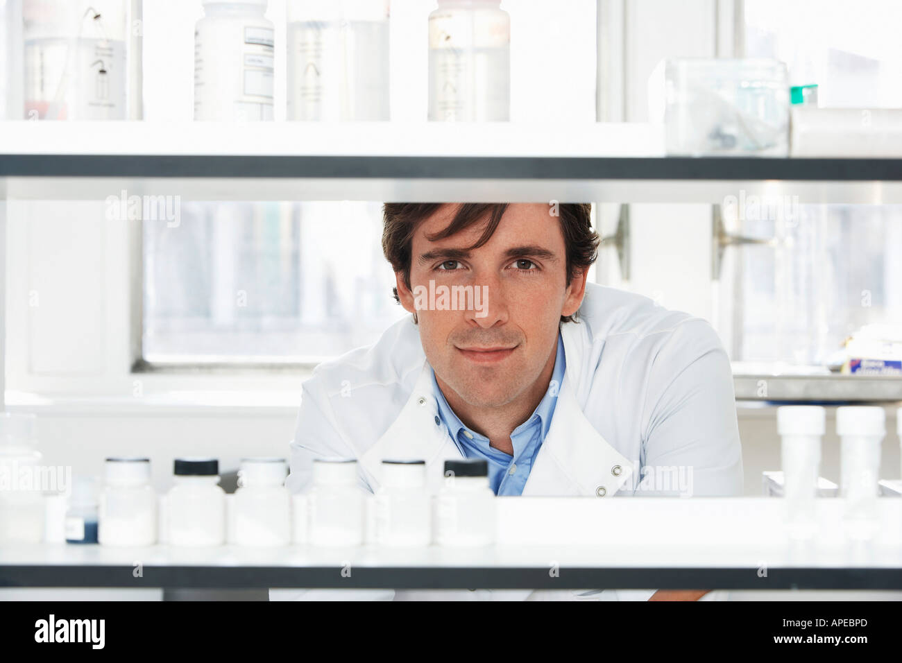 Lab Worker Looking Through Shelves - Stock Image