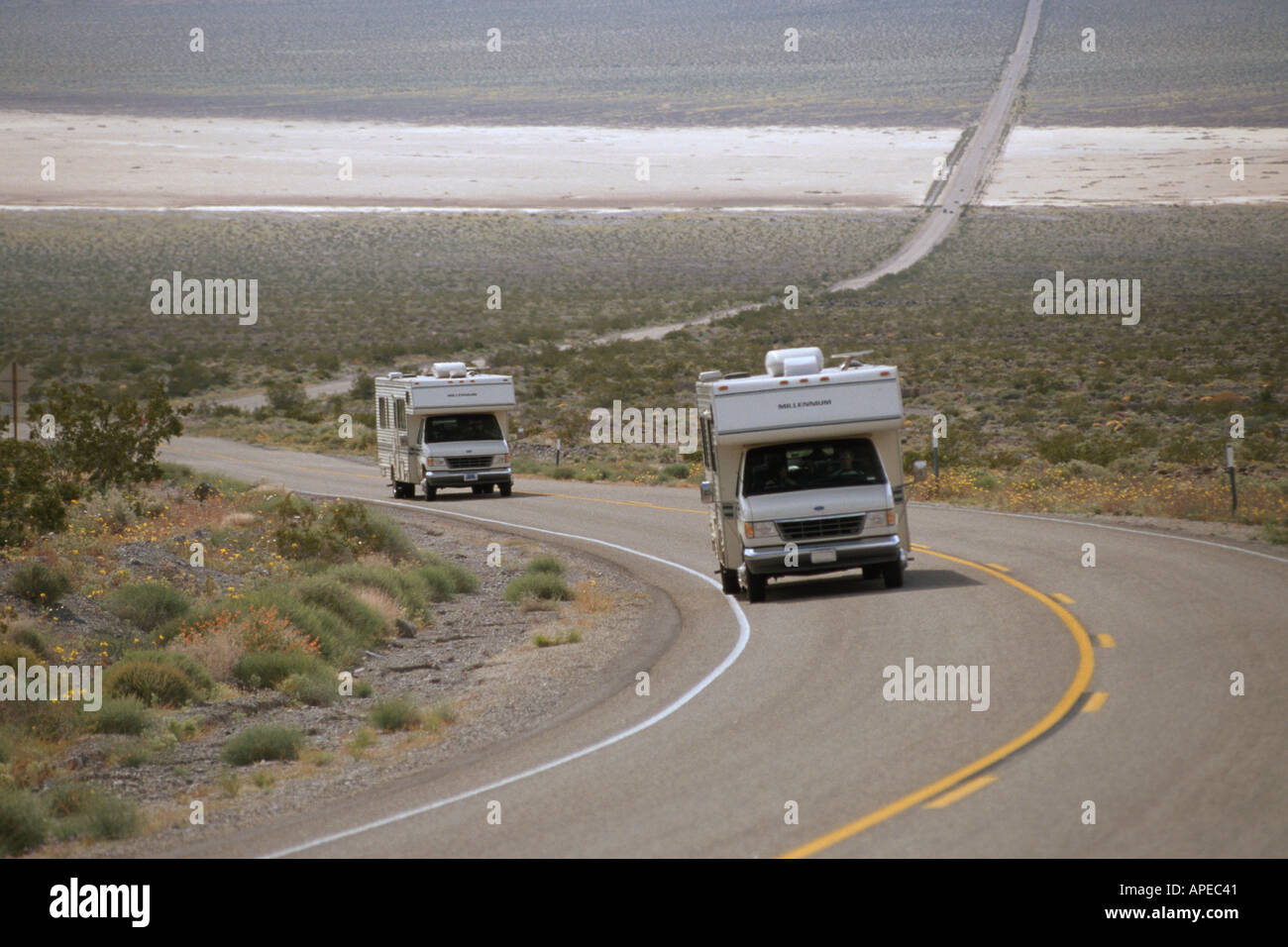 Recreational vehicle camper driving on curve of long empty desert highway near Death Valley National Park California Stock Photo