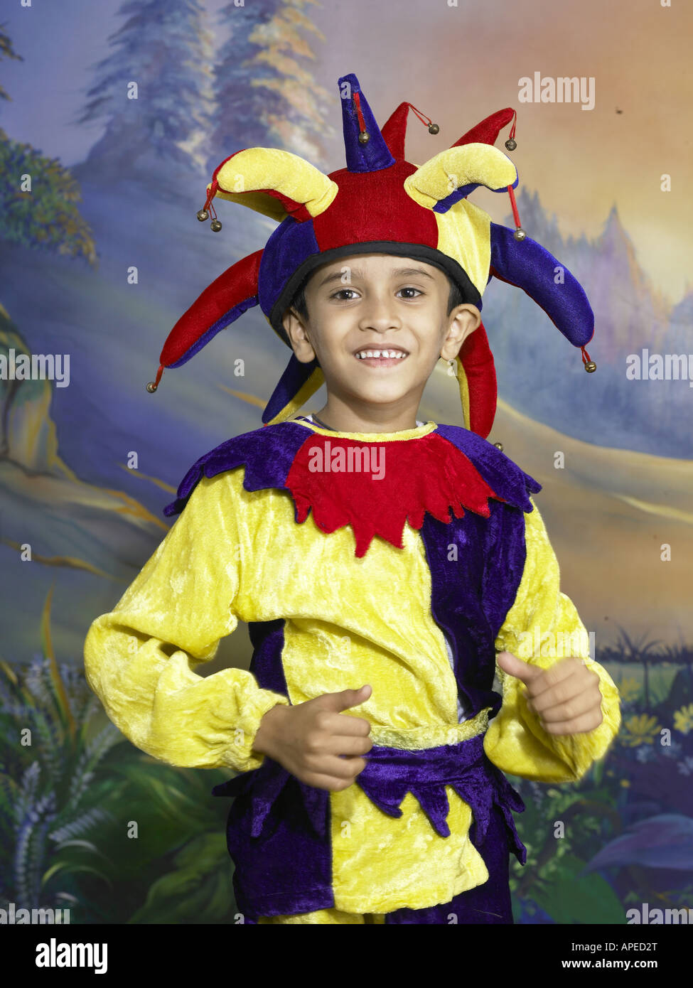 18da55255 South Asian Indian boy dressed as joker performing fancy dress competition  on stage in nursery school MR