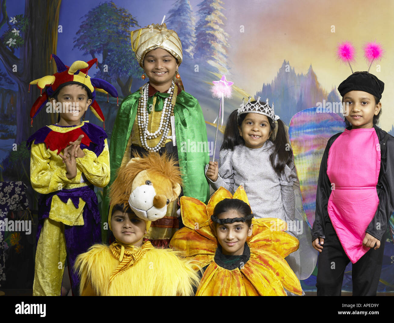 492fcc30d0 South Asian Indian boys and girls performing fancy dress competition on  stage in nursery school MR