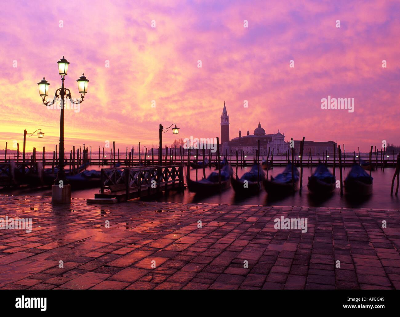San Giorgio Maggiore from the Molo Gondolas in foreground Dawn view Venice Veneto Italy - Stock Image