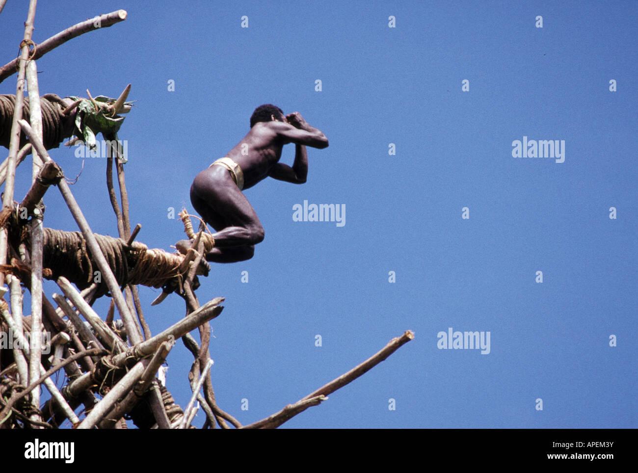 Pacific Ocean, Vanuatu, Pentecost Island, Native Islander jumping off platform - Stock Image