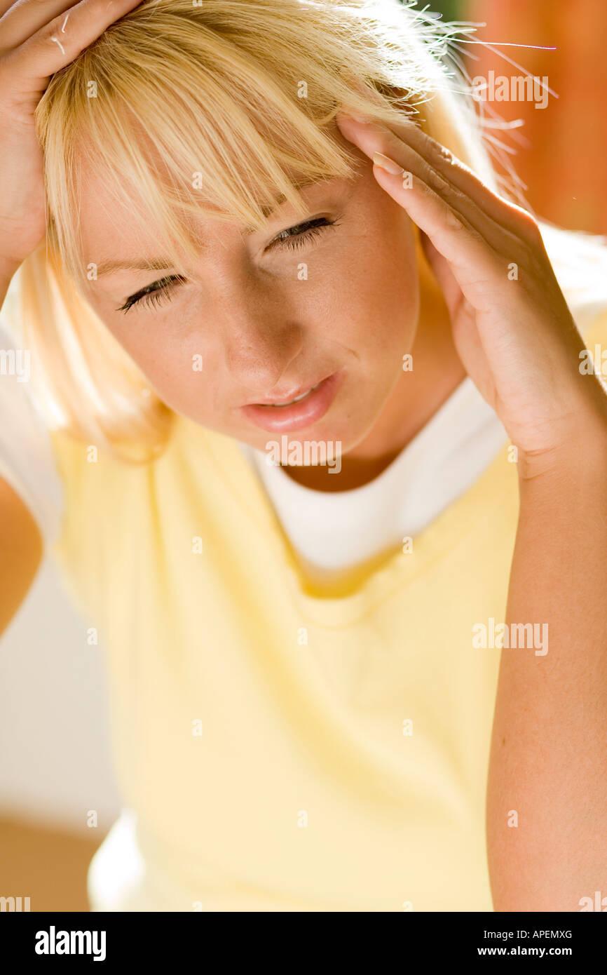 woman with headache - Stock Image
